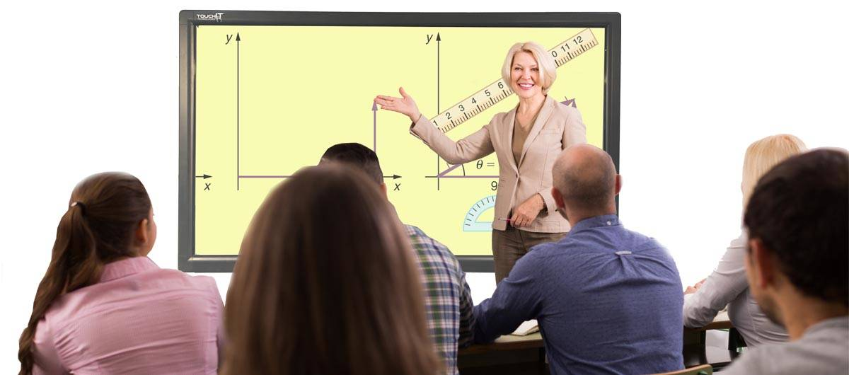 Teacher Standing In Class Using Interactive LED
